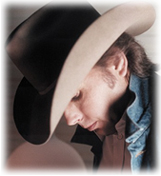 Country singer, Dwight Yoakam, wearing his classic Stetson cowboy hat.