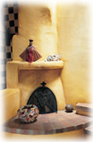 A warming kiva fireplace in a Taos home.